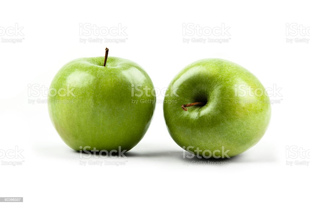Two Shiny green apples aside each other stock photo