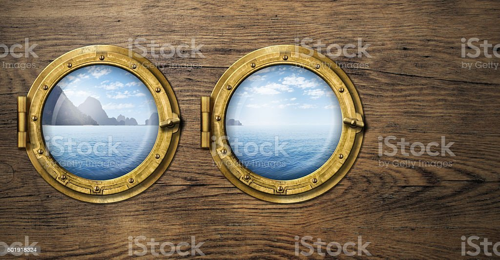 Two ship windows with tropical sea or ocean island. Travel stock photo