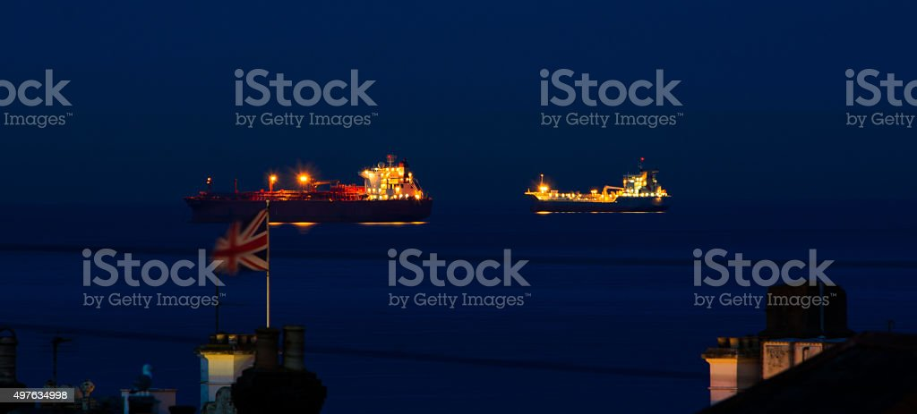 Two Ships, The British Flag and a Seagull. stock photo
