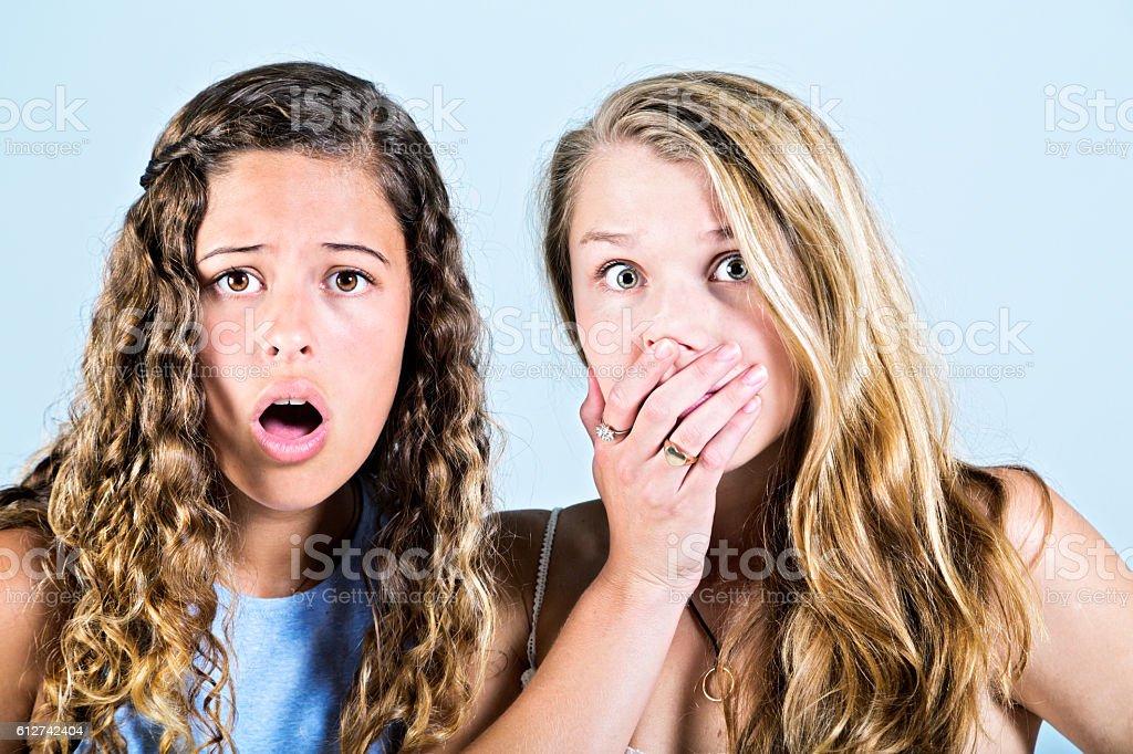 Two shocked, saddened, and horrified young beauties stok fotoğrafı