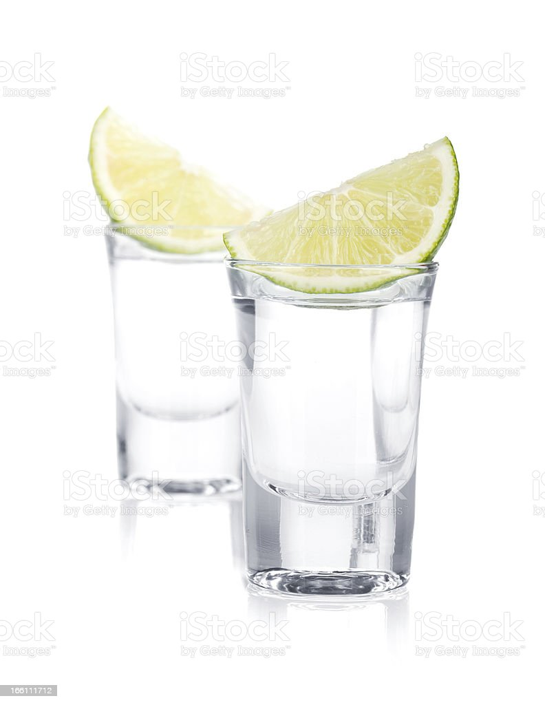 Two shots of vodka and lime slice stock photo