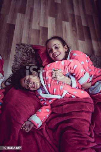 Two Sibling Girls Preparing To Sleep After Bath