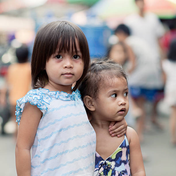 two siblings - philippines girl stock photos and pictures