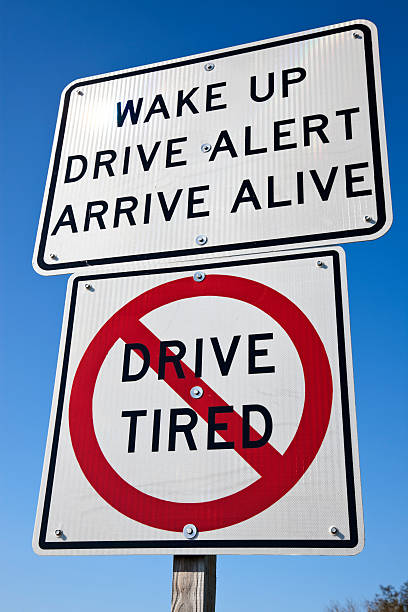 Two signs to warn drivers to not drive while tired stock photo