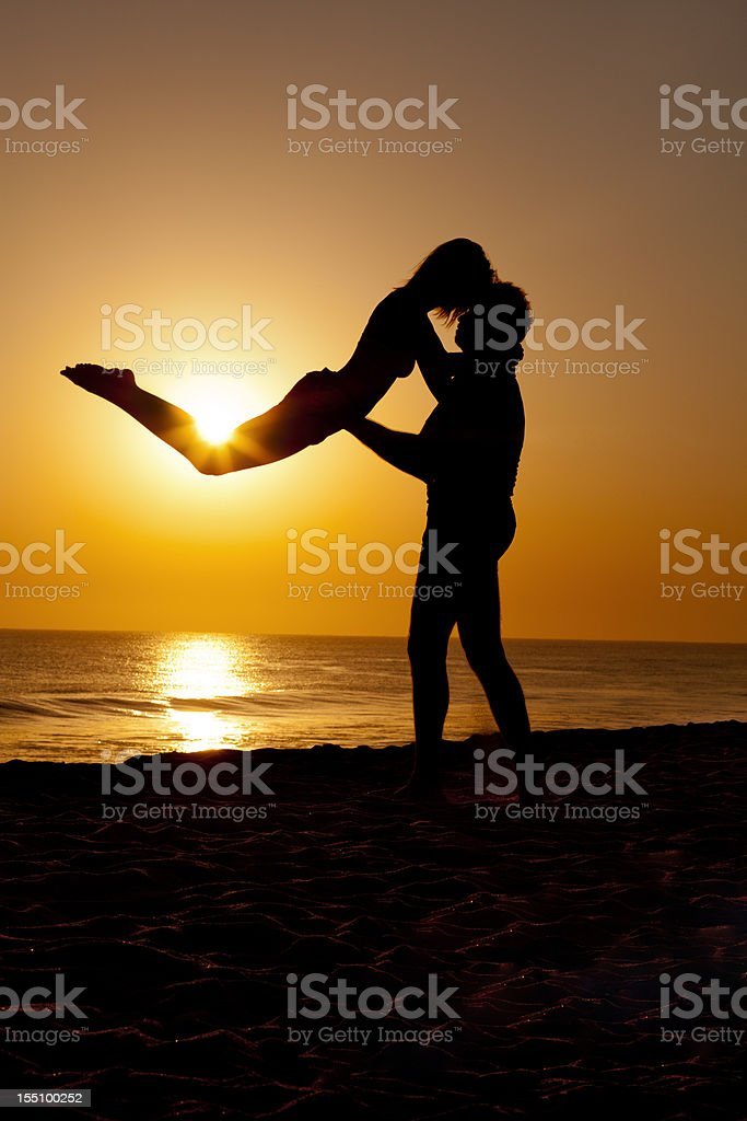 Two silhouettes in the sunrise royalty-free stock photo