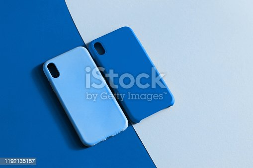 Silicone smartphone cases in two shades of blue. Color of the year 2020 Classic Blue. Protective silicone cases for phone. Selective focus.