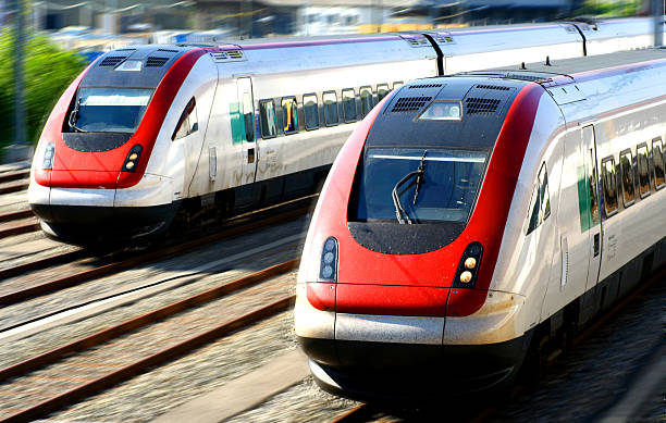Two silver and red trains head to head stock photo