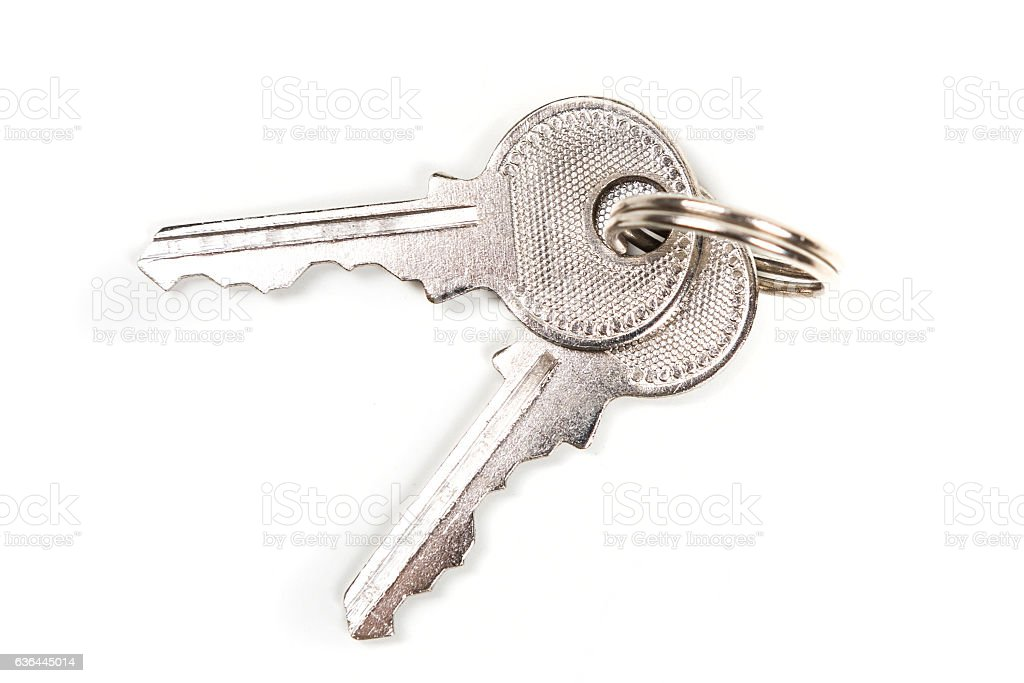 Two silver keys isolated on white background stock photo