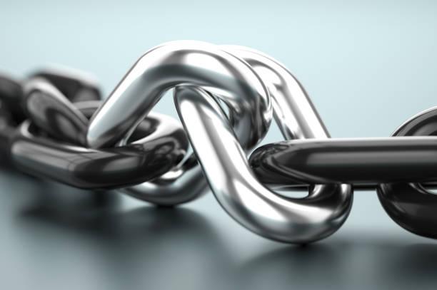 two silver links with black chain. partnership concept - anello catena foto e immagini stock