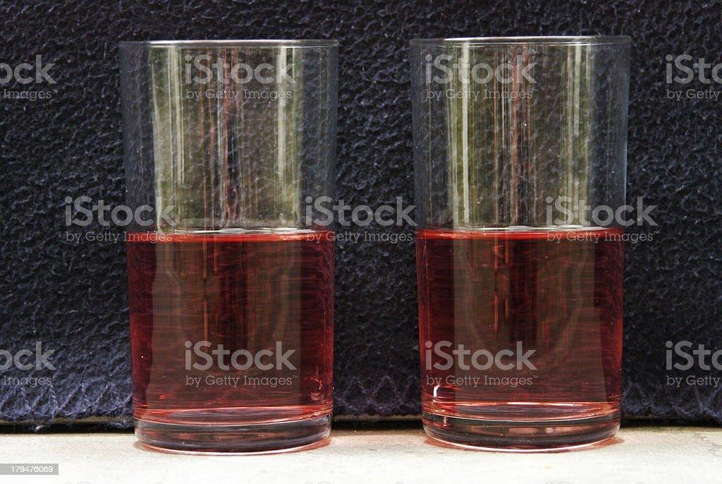 Two similar glasses royalty-free stock photo