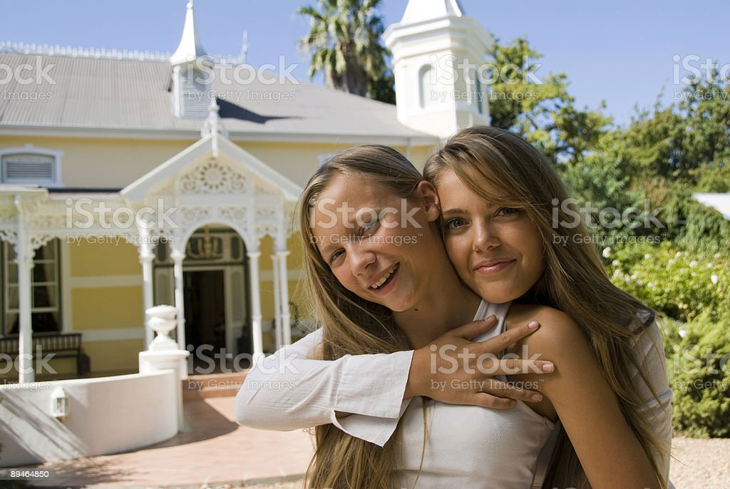 two sisters at home royalty-free stock photo