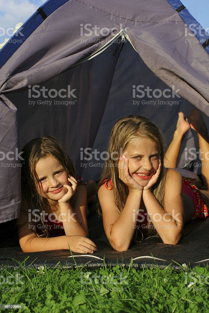 Two sisters camping royalty-free stock photo