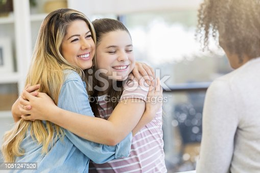 istock Two sisters embrace as they receive good news from doctor 1051247520