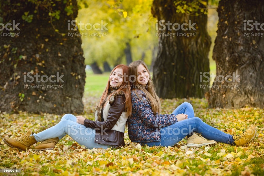 Two sisters in a park royalty-free stock photo