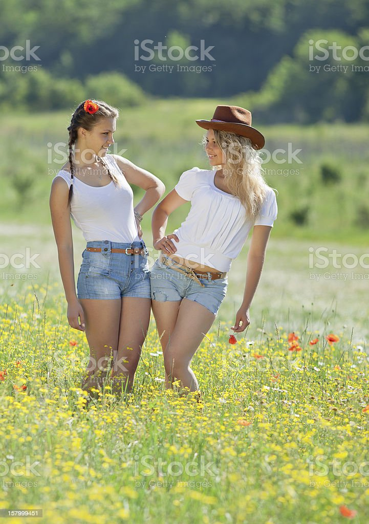 Two sisters in field stock photo