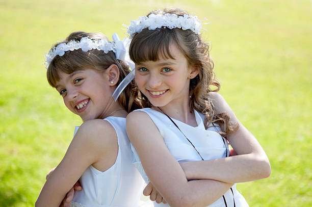 two sisters - communion stock pictures, royalty-free photos & images