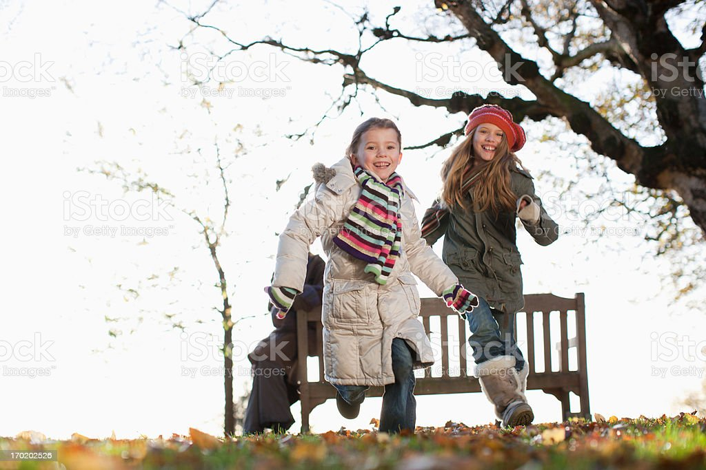 Two sisters playing outdoors in autumn royalty-free stock photo