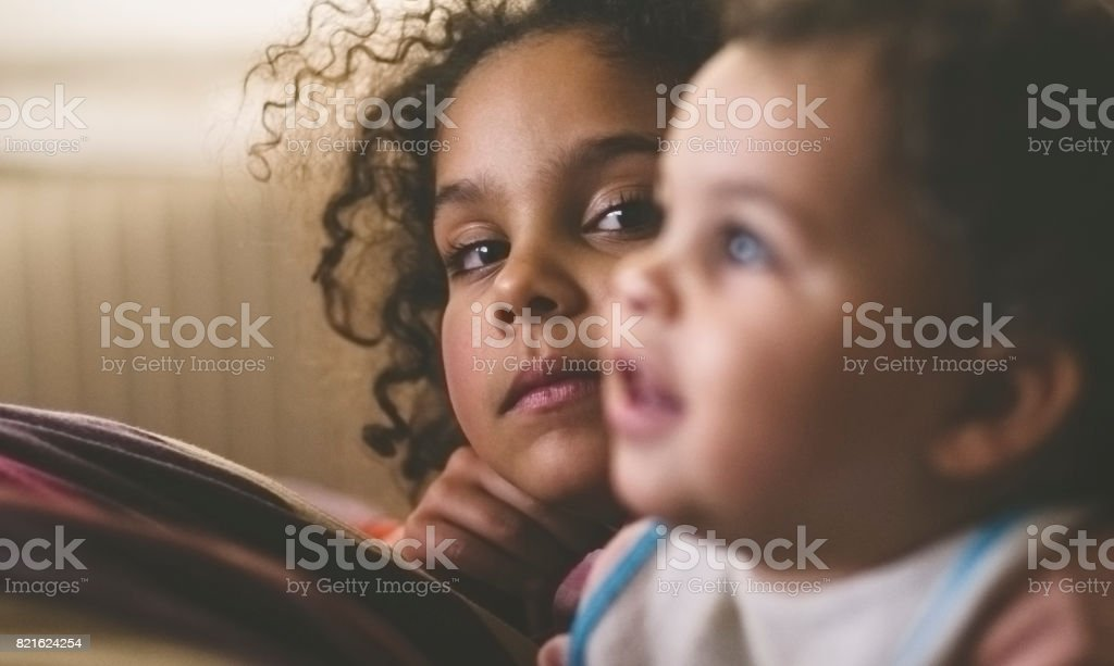 Two Sisters Watching TV stock photo