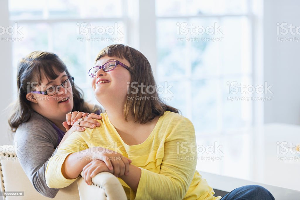 Two sisters with down syndrome stock photo