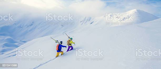 Two skiers climbing up a snowcovered hill picture id531541598?b=1&k=6&m=531541598&s=612x612&h=bmi4smkfl z3wek420dlesl8y0e7fzdmsofheg5 fzg=