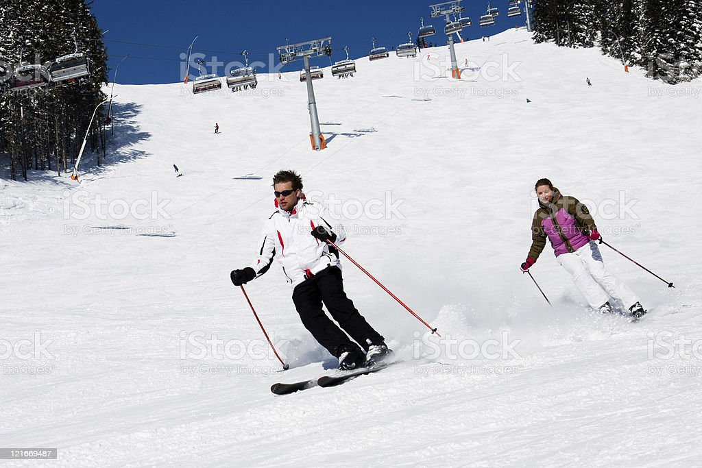 Two skiers downhill skiing royalty-free stock photo