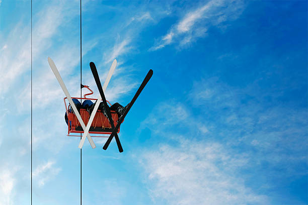two skiers on a chairlift stock photo