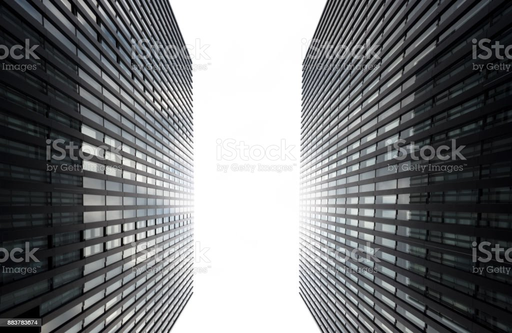 Two skyscraper walls from below with bright sunlight. stock photo
