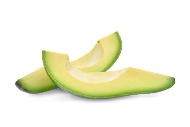 two slice of fresh avocado isolated on white background stock photo