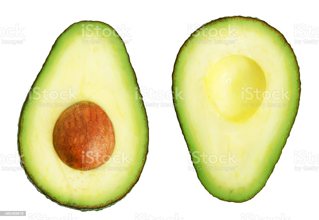 Two slices of avocado stock photo