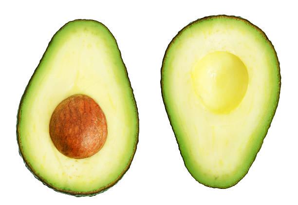 Two slices of avocado stock photo
