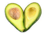 Two slices of fresh avocado with heart symbol isolated on the white background, in healthy concept with clipping path.