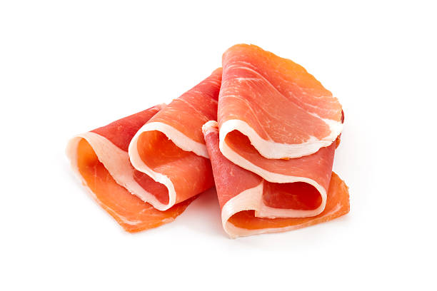 Two slices of prosciutto on a white background stock photo