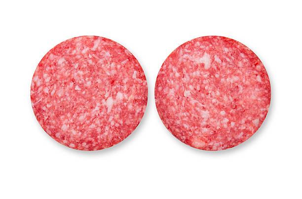 zwei scheiben salami wurst - hajohoos stock-fotos und bilder