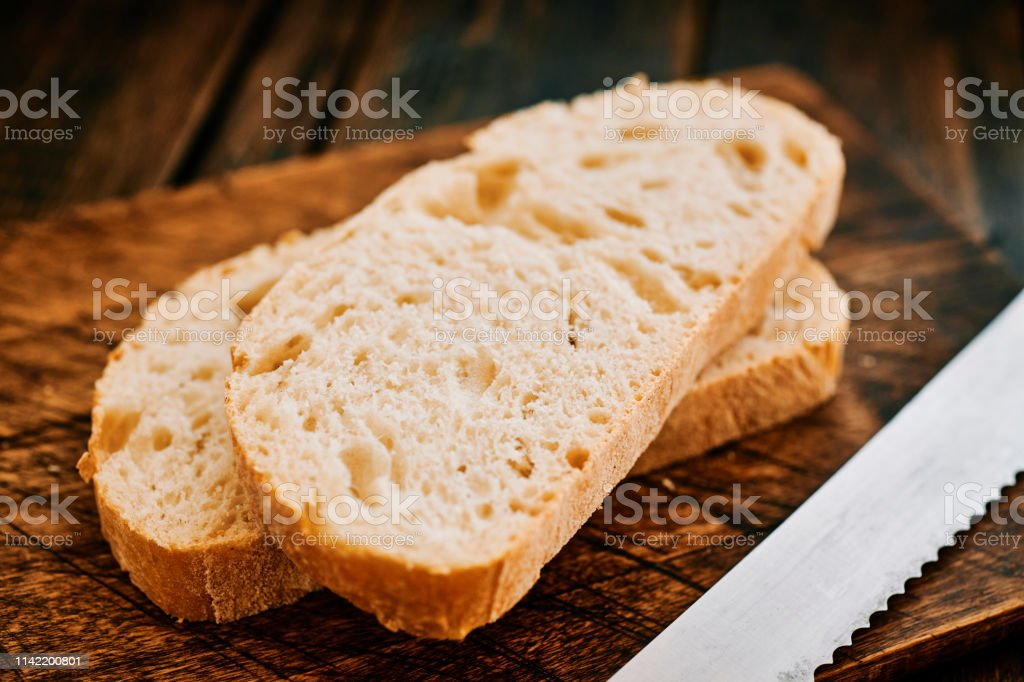 Two slices of Sourdough Bread on a rustic chopping board. stock photo