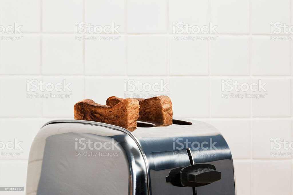 Two slices of toast in toaster stock photo
