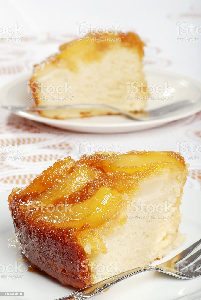 two slices of upside down pear cake stock photo