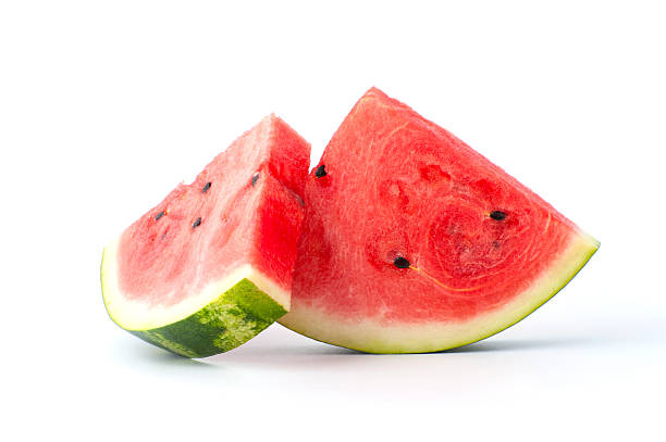 two slices of watermelon on a white background. - karpuz stok fotoğraflar ve resimler