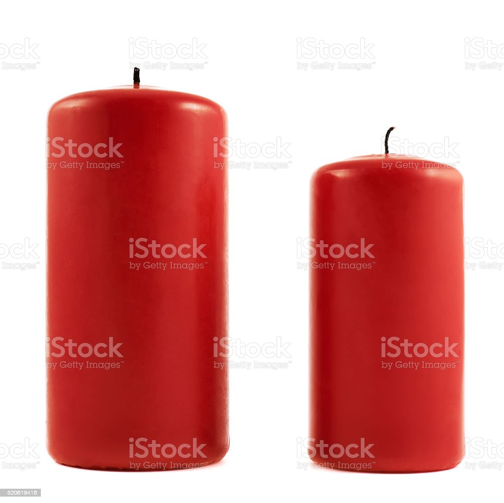 Two small and big red candles stock photo