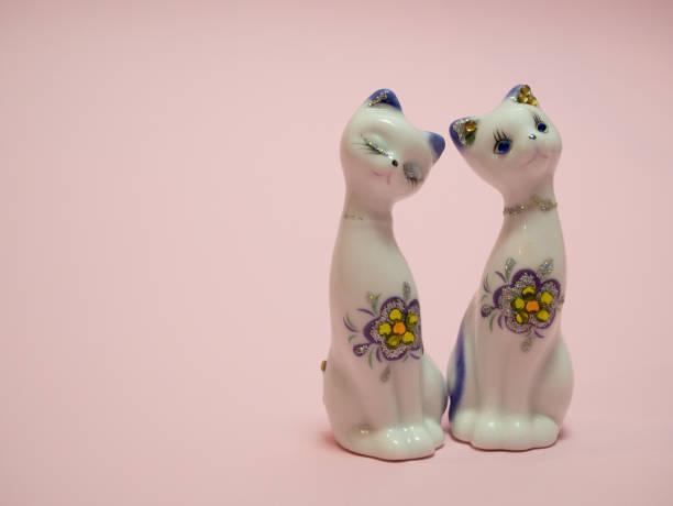 Two small ceramic cats on pink background picture id1127290515?b=1&k=6&m=1127290515&s=612x612&w=0&h=kpaxpenb rzrq64mwnswjqetcqc1pl52fhfnji3zhie=