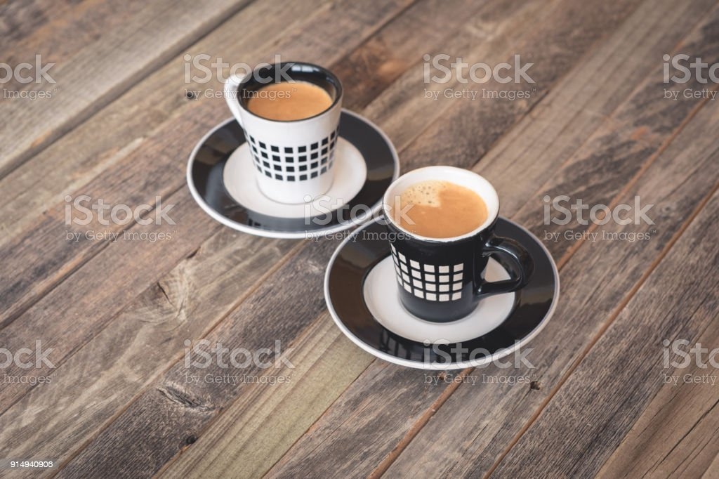 Two Small Coffee Cups On Wooden Background Stock Photo More