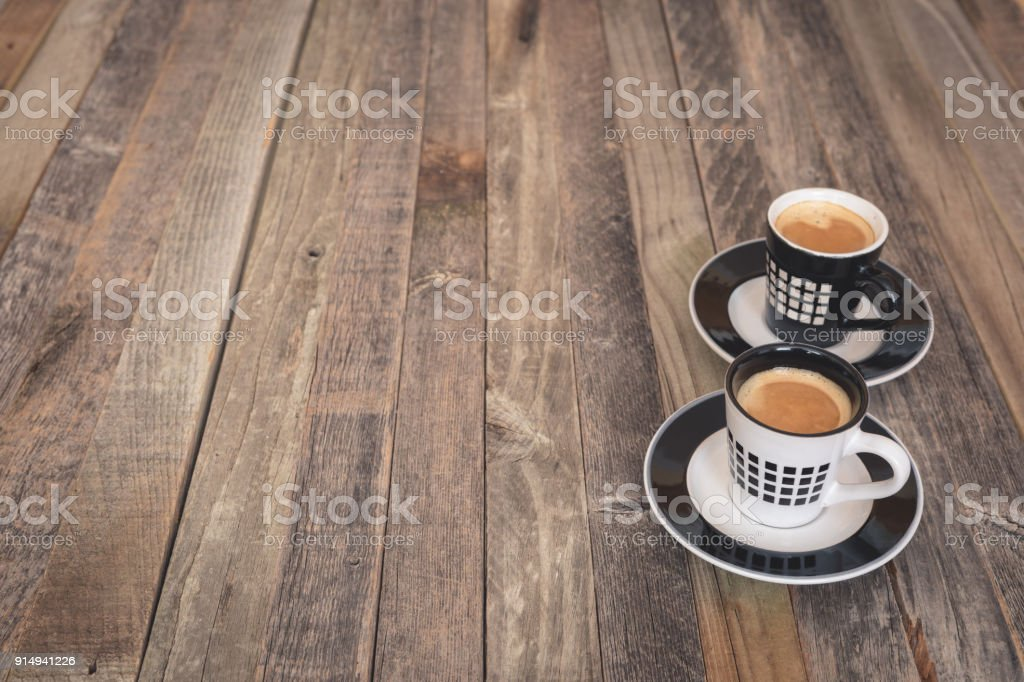 Two Small Coffee Cups On Wooden Background Stock Photo Download