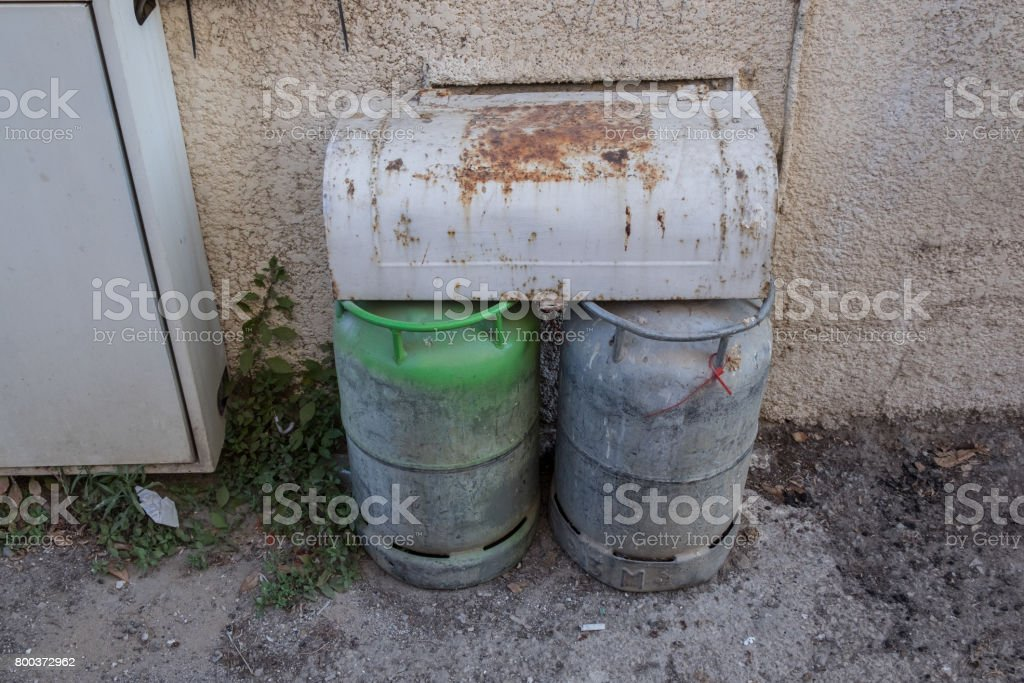 two small gas tanks used for home cooking connected to internal pipes stock photo