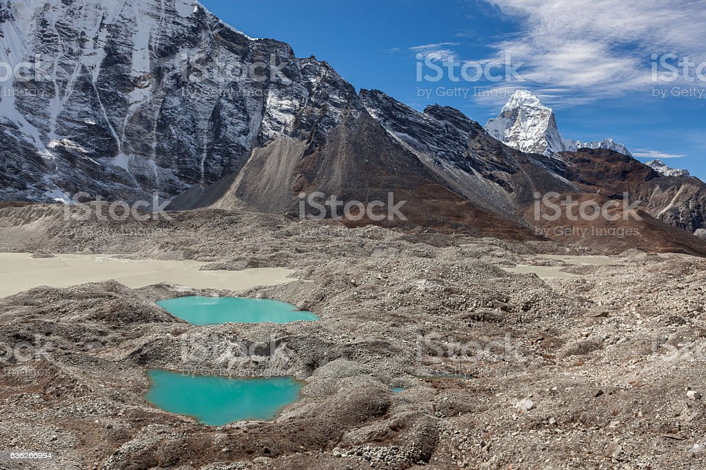 Two small moraine lakes of turquoise color and snowy stock photo