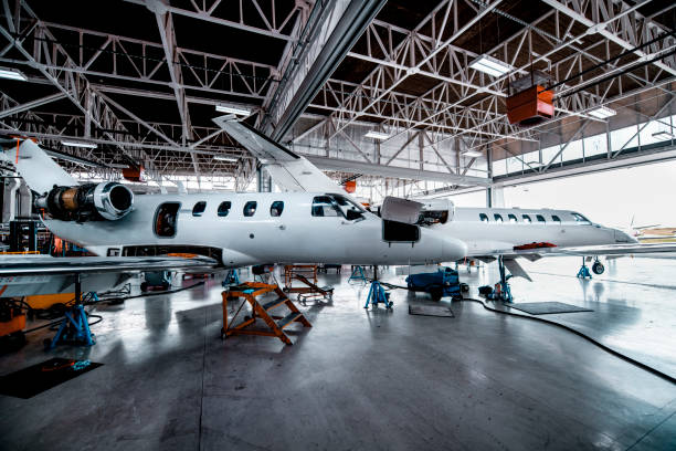 Two small private planes in a maintenance hangar stock photo