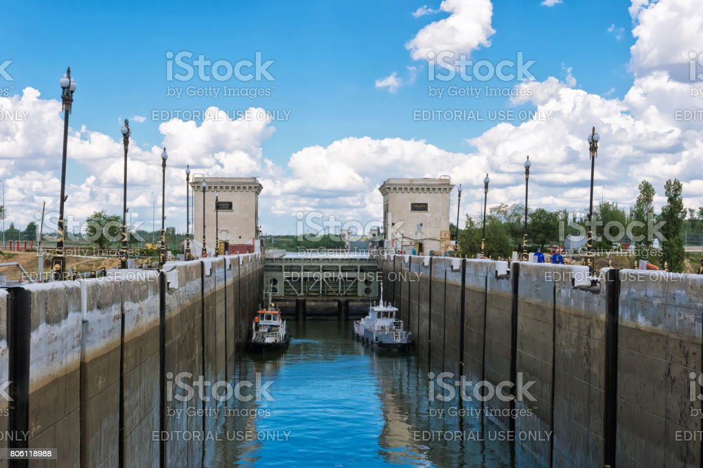 Two small repair of the ship are locking in the waterlock of the dam a navigable channel stock photo