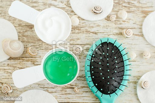 istock Two small scoops with hair mask (conditioner) and green gel with spirulina and marine collagen extracts. Spa and natural skin and hair care concept. Top view, copy space. 1040464400