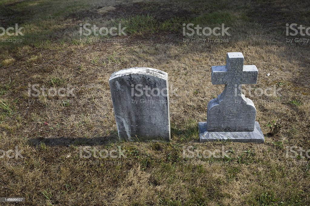 Two small tombstones stock photo