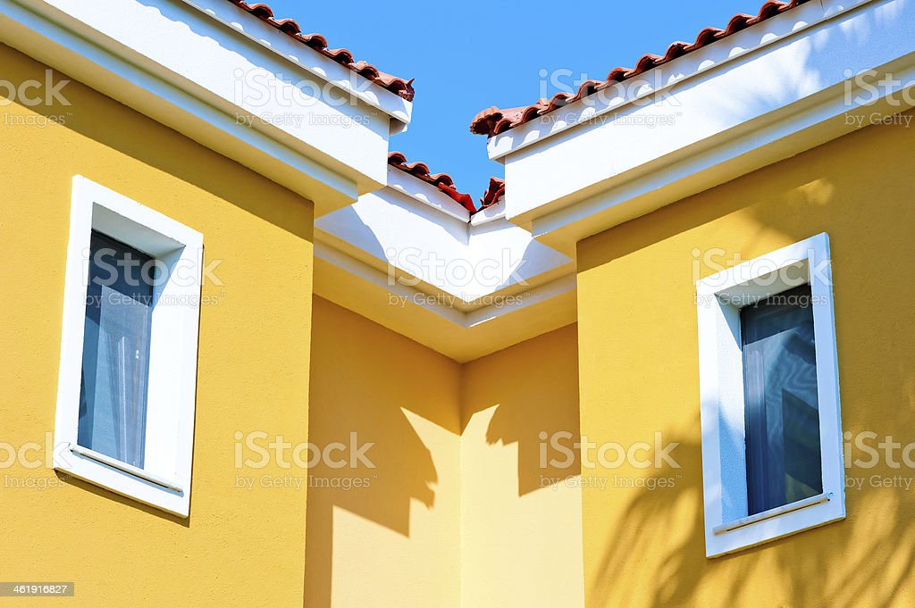 two small windows in the attic under roof stock photo