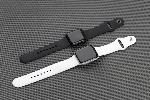 Two smart watches Apple Watch on a gray background.