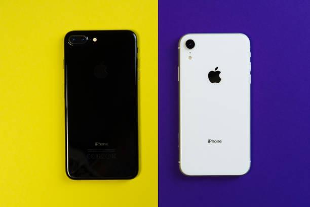 Two Smartphone Yellow Purple Background Flat Lay stock photo